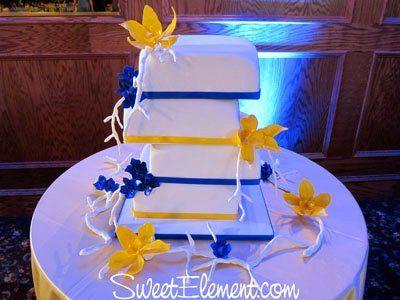 Tmx 1332532703378 Offsetsquareblueyellowweddingcakecymbidiumorchiddelphiniummanzanitabranches East Orange wedding cake