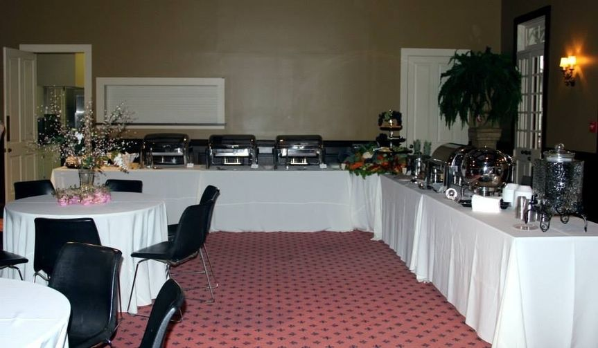 A view of the food buffet table.   Food Items included:   Brisket, Rice Dressing, Fried Fish,...