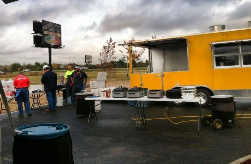 Cajun Commander Catering cooking Crawfish Etouffee and Fried Fish to serve 300 guests attending the...
