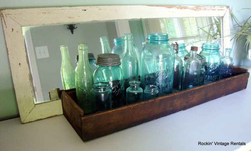 This is one of our vintage mirrors, a wood box and some old jars. Imagine it with your flowers and...