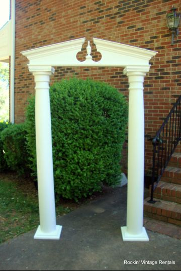 Wedding Arch made with old porch columns. It requires no tools for set up!