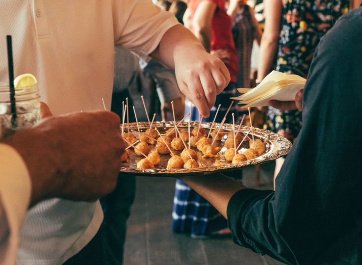 Hand-passed fried pimento cheese balls at a wedding reception at our private venue.