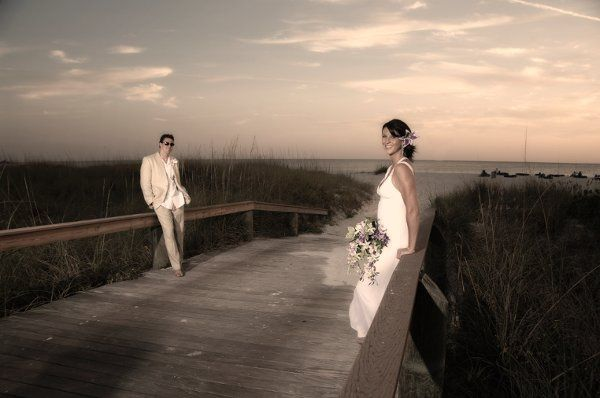 Bride and groom on the bridge at the Grand Plaza Resort