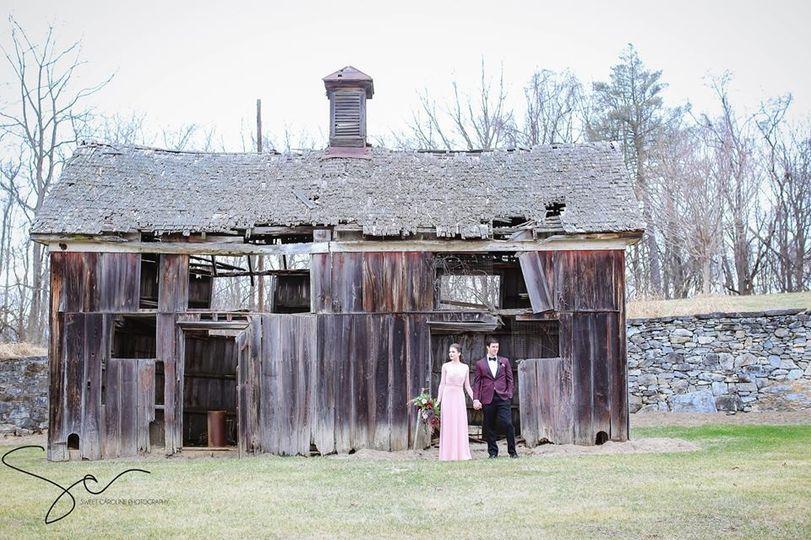 Couple by a rickety barn