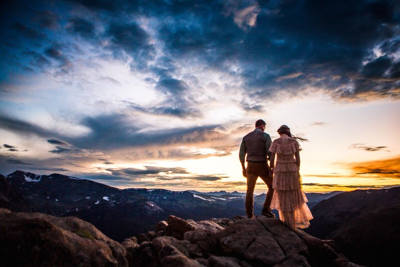 bride and groom watching sunset in rocky mountain national park bohemian style estes park jmgant photography 51 661907 v2