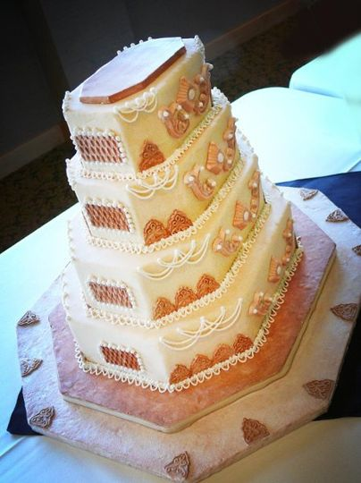 Octangular Wedding Cake with Piping, Scroll Work and Pearls.