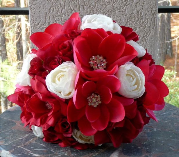Red handpainted Magnolias along with Open Red Roses and filled with Rhinestone Bling!  This is...