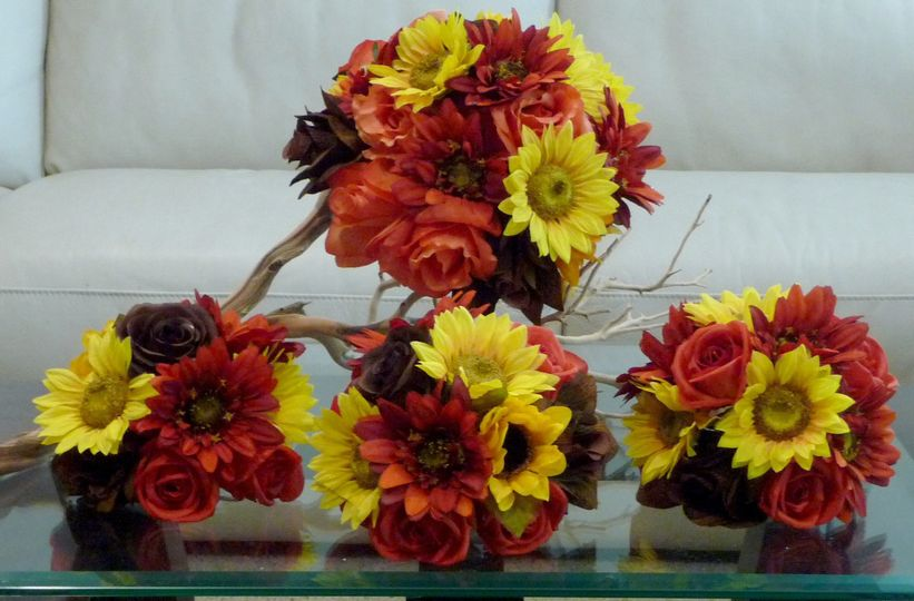 Fall flowers of Oranges, Brown Confetti Roses, Rust Gerbera Daisies, with yellow sunflowers in a...