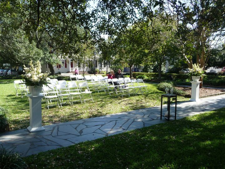 Wedding Ceremony in one of Savannah's many Squares! Rent our white Wooden plant stands and floral...