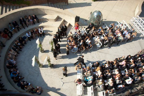 Ceremony in outdoor amphitheater.  Image courtesy of Sachs Photography.