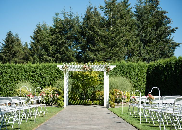 Outdoor wedding setup with decorated arbor