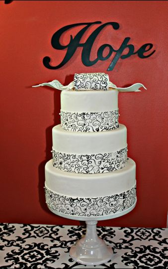 Three tier white fondant cake with printed band on each tier.