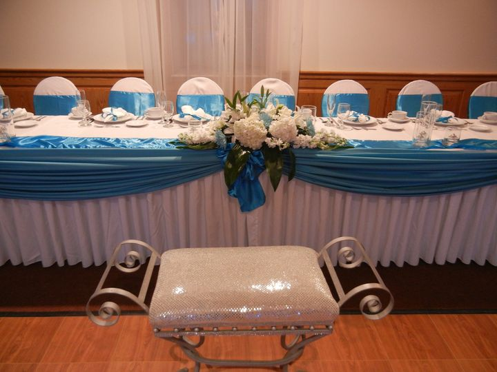 Long head table with floral centerpiece