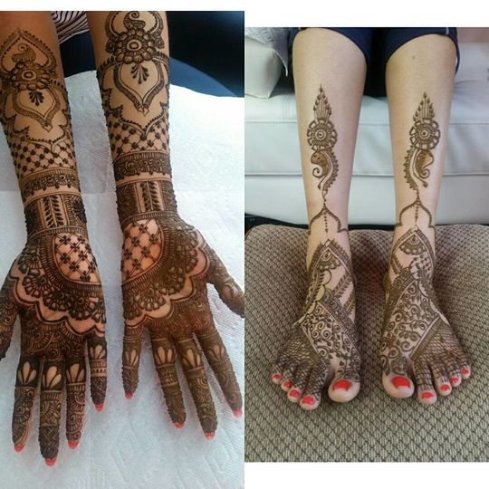 Hands and feet covered in henna