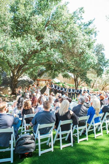 Guests seated in an outdoor reception
