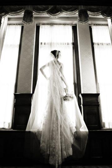 Bride standing in front of window
