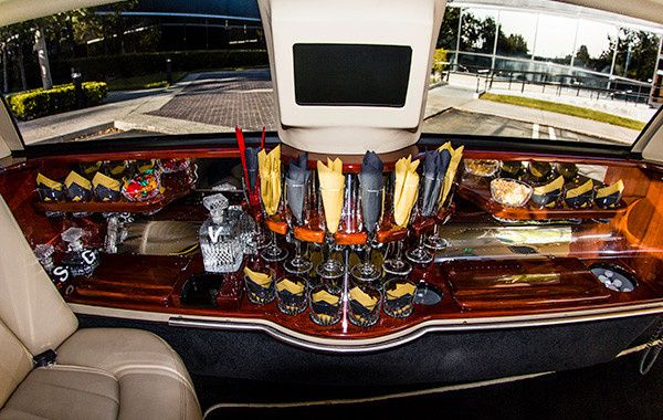Lincoln Stretch Limo Interiors with Champagne glasses.