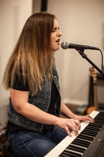 Toria playing piano