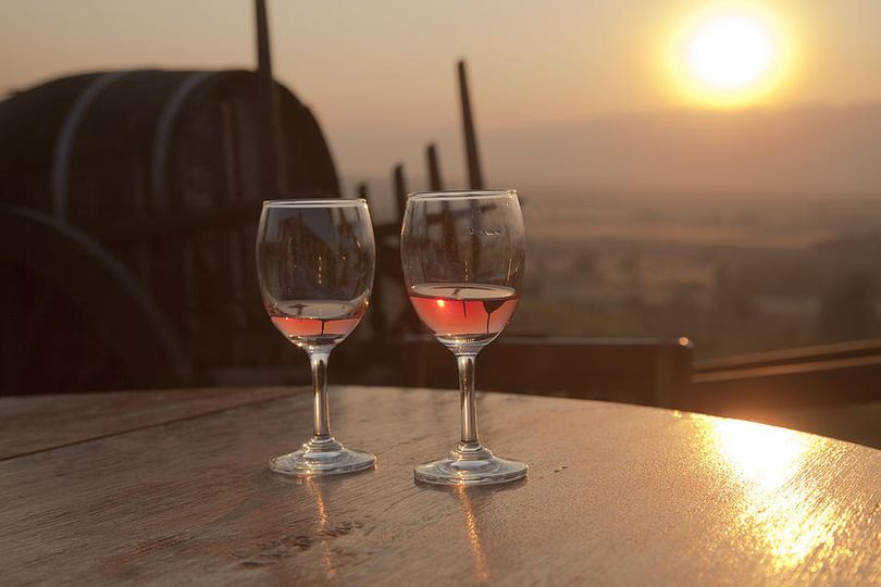 romantic sunset with a glass of wine maria heyens 51 1033117