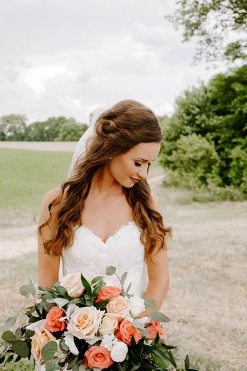 Bride posing with a fresh bouquet of flowers