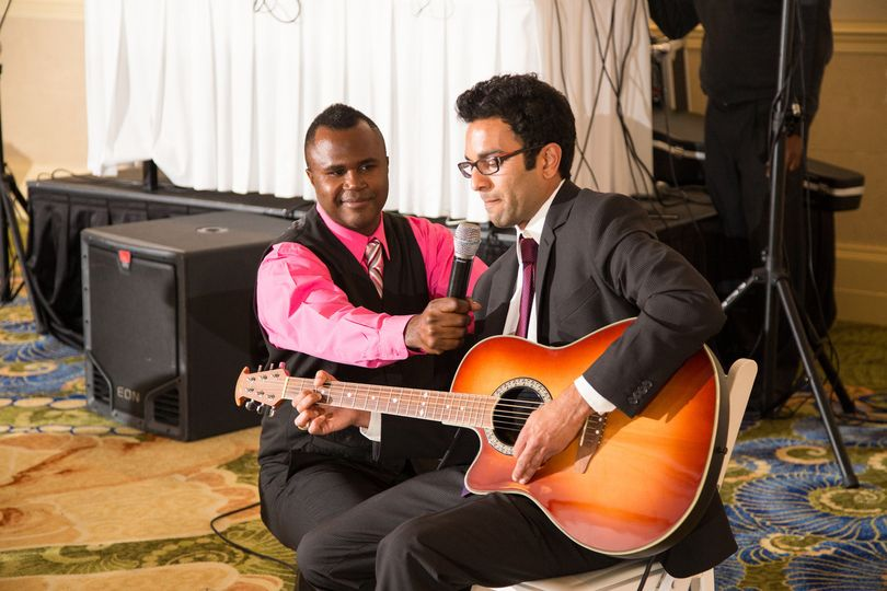 wedding guest playing guitar