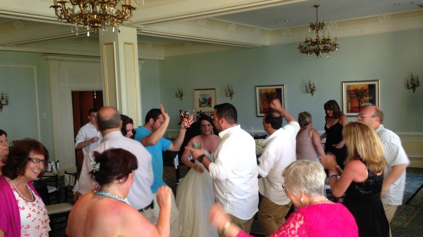 bride dancing on dance floor w guests