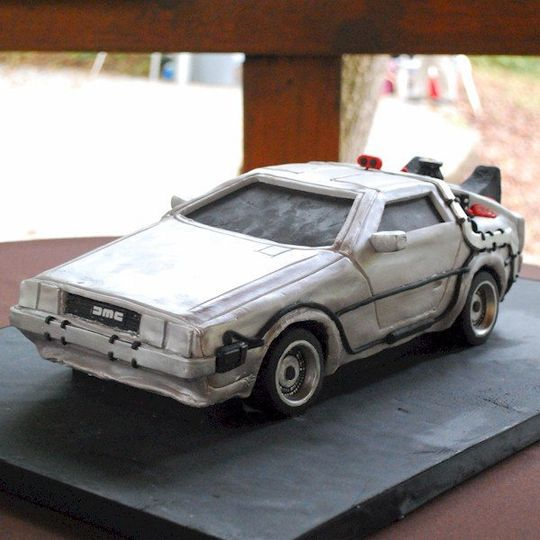 Sculpted scale model Back to the Future DeLorean groom's cake