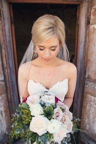 Bride's bouquet in hand