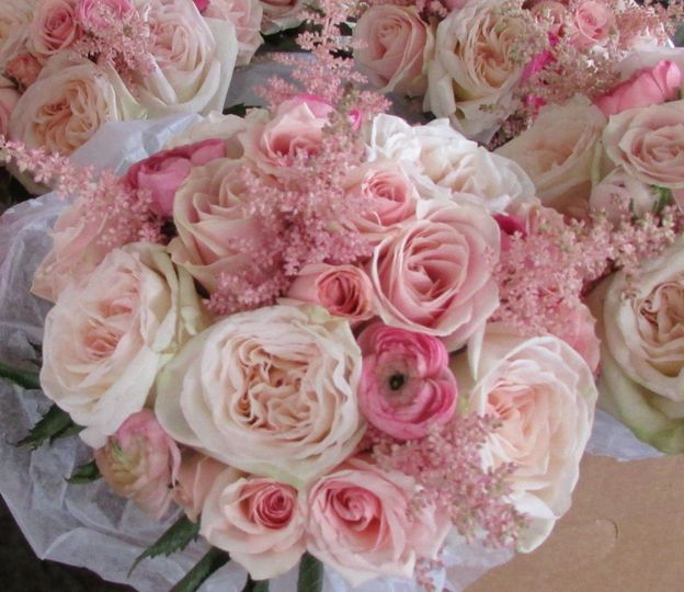 Pink bouquet of garden roses, roses, ranunculus, and astilbe. Very romantic!