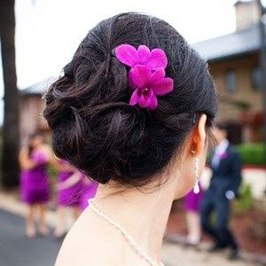 Hair updo complemented with purple flower