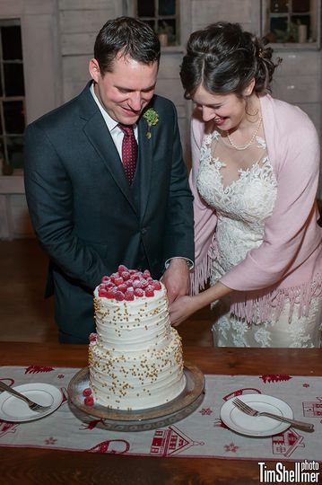 Toasted coconut cake with raspberry buttercream filling, vanilla buttercream frosting in a ribbon...