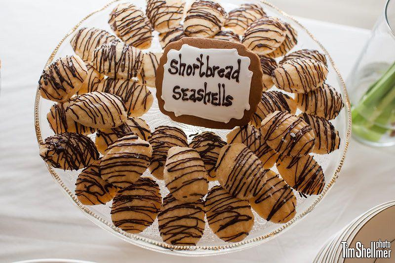 Shortbread seashells drizzled with dark chocolate, garnished with flecks of sea salt.