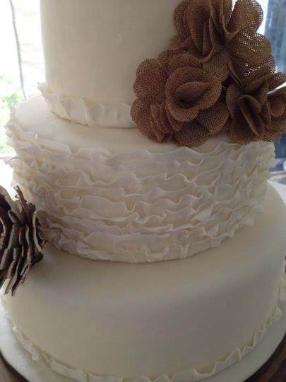 Close-up of burlap and lace wedding cake