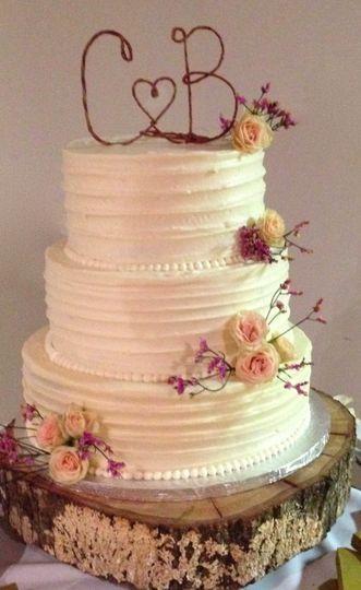 Apple brandy cake with vanilla buttercream ribbon swirl finish.