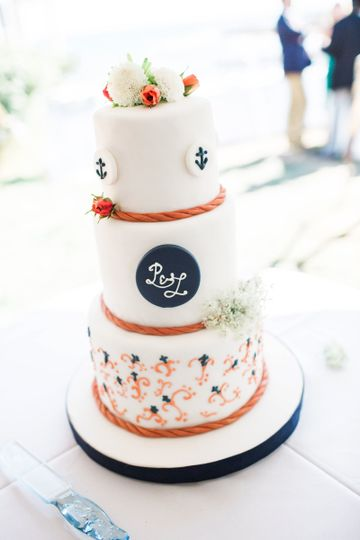 Darling little nautical cake featuring fondant roping and anchor medallions.
