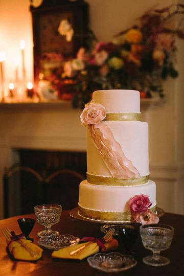 Ruffles and roses with gold bands and teardrop piping.  Photo by Courtney Elizabeth Media.