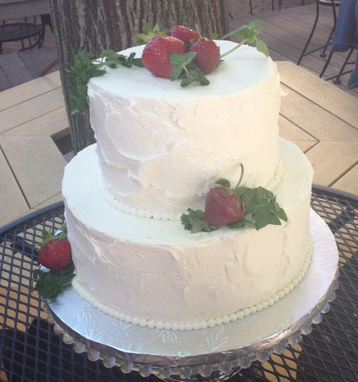 Chiffon cake filled with whipped cream and crushed strawberries.  Vanilla buttercream frosting.