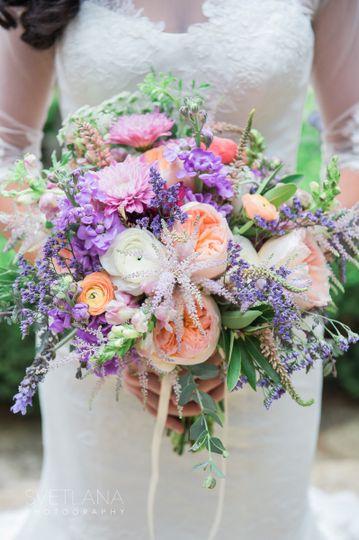 Bride holding her lavender bouquet