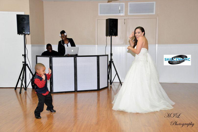 Bride dancing with the junior groomsman
