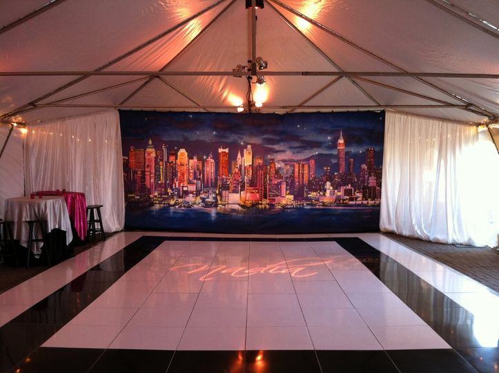 White and black dance floor with draping.