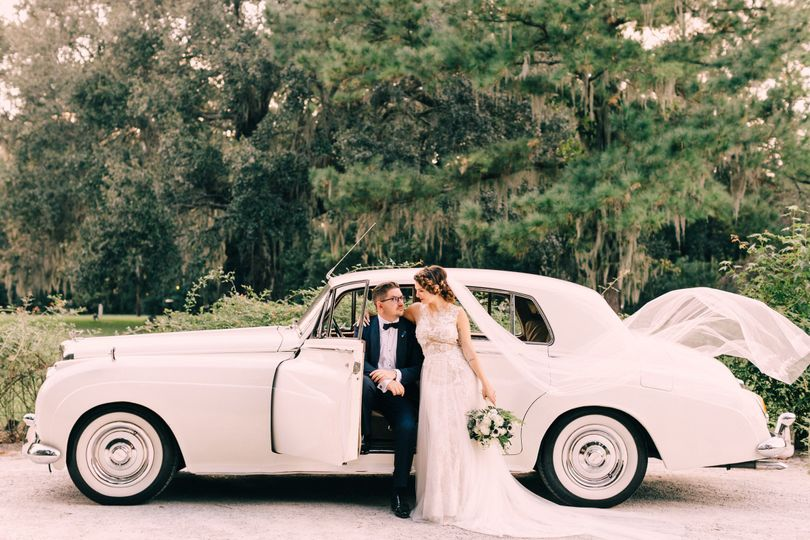 Couple posing with car