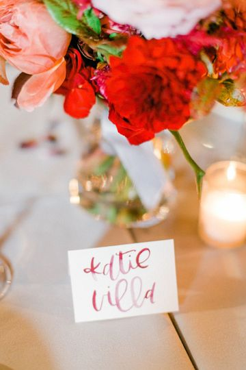 Deep red watercolor calligraphy on blush place cards. Photography by Vanessa Marie Weddings...