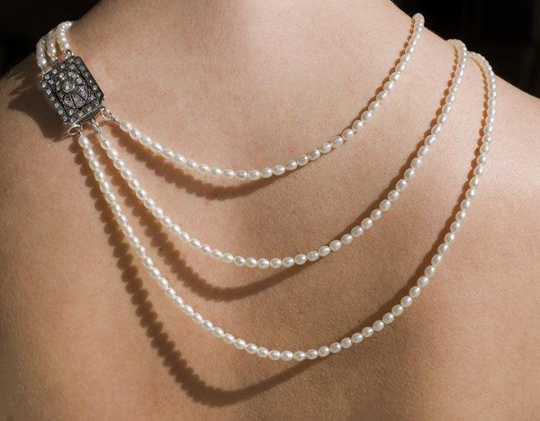 triple strand pearl necklace with vintage pave clasp