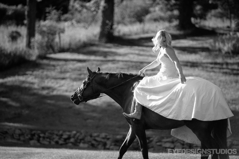Riding a horse in wedding dress