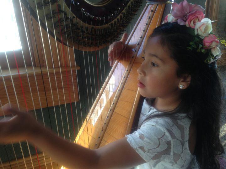 Flower girl playing harp