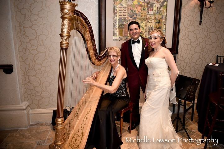 Newlyweds with the harpist