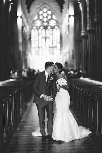 Couple walking down aisle