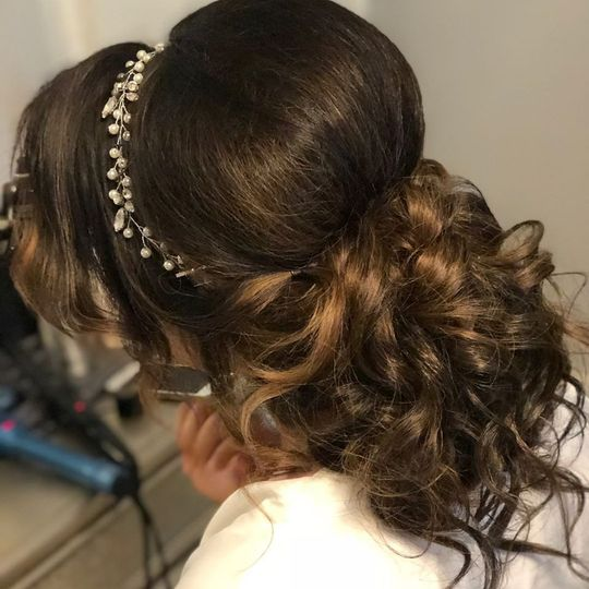 Updo with curls and headpiece