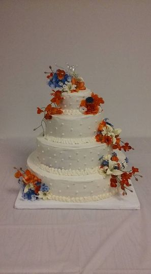 Buttercream with orange and blue silk flowers