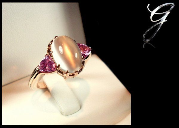 An alternative to the traditional wedding/engagement ring.  Moonstone center with pink tourmaline...
